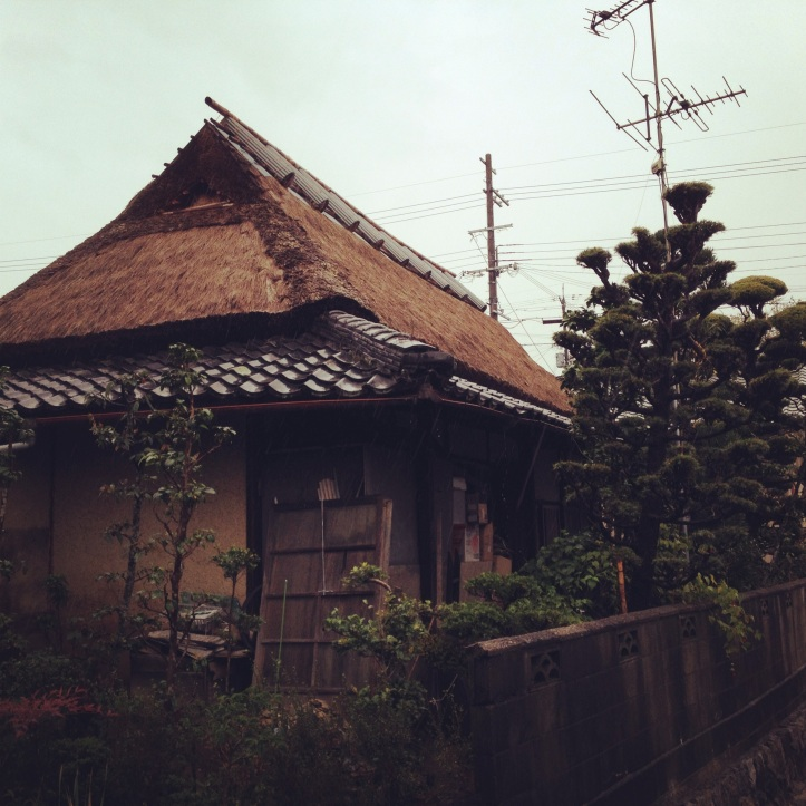 Japanese home with thatched roof in rural Osaka Prefecture.