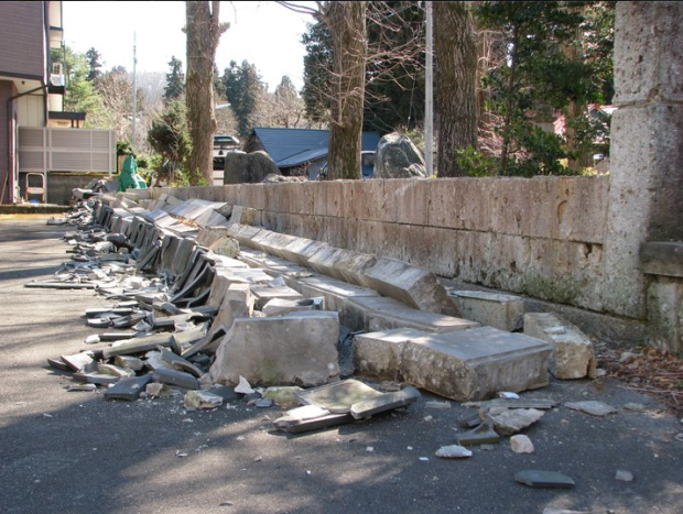 A collapsed wall of a local shrine in the village Jeff lived in.
