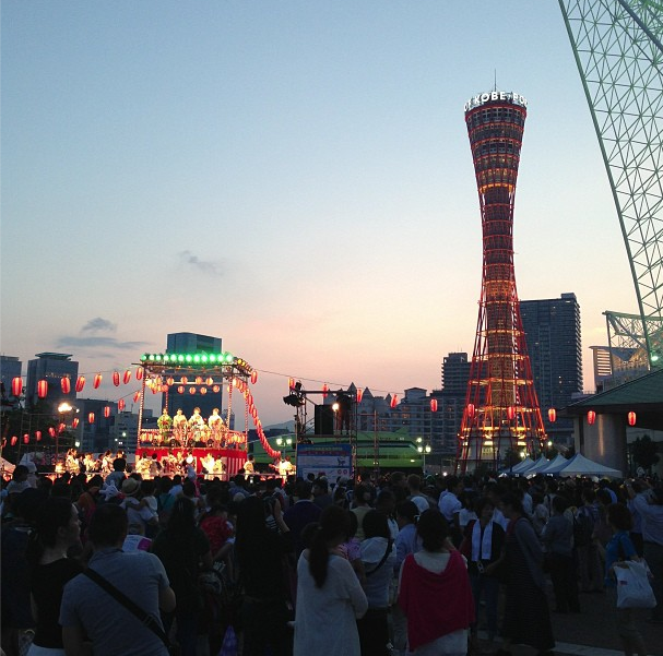 A photo from Dimitri Perrin's Instagram of the Kobe, Japan waterfront during a festival.