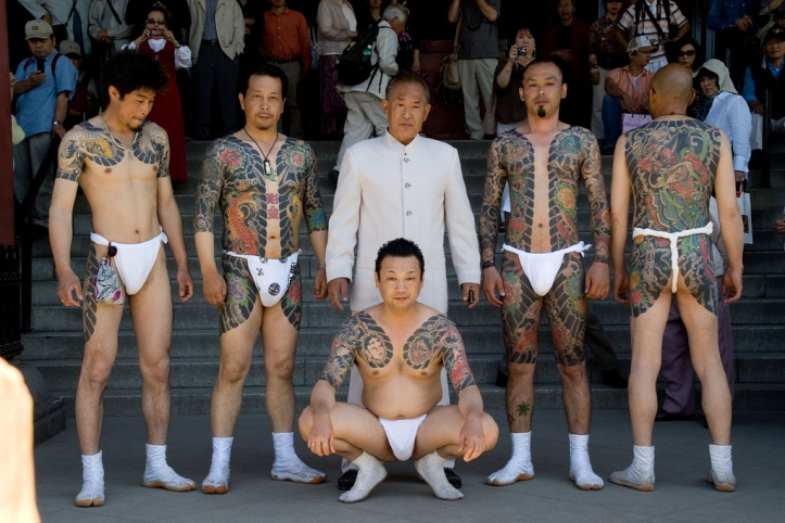 Yakuza members display tattoos at matusri in Tokyo (via Wikipedia/Wikicommons)