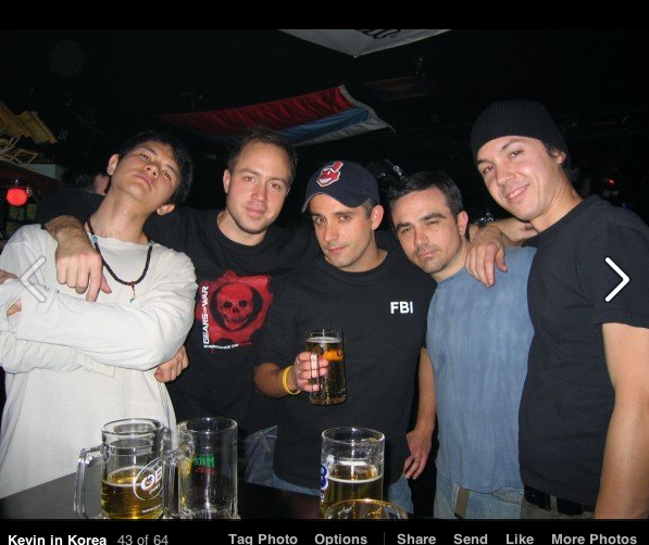 Just Japan Podcast host Kevin (wearing FBI shirt) with his band in Busan, Korea in 2006 (at an expat bar called the Underground).